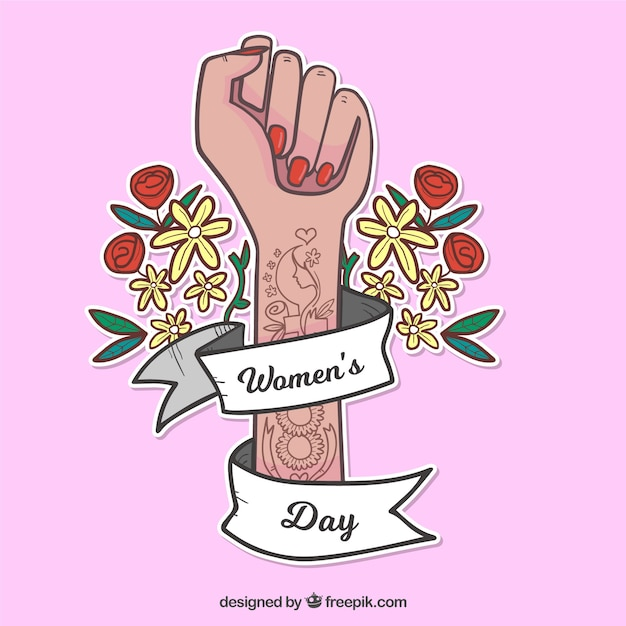 Womans day background with tattooed arm Free Vector