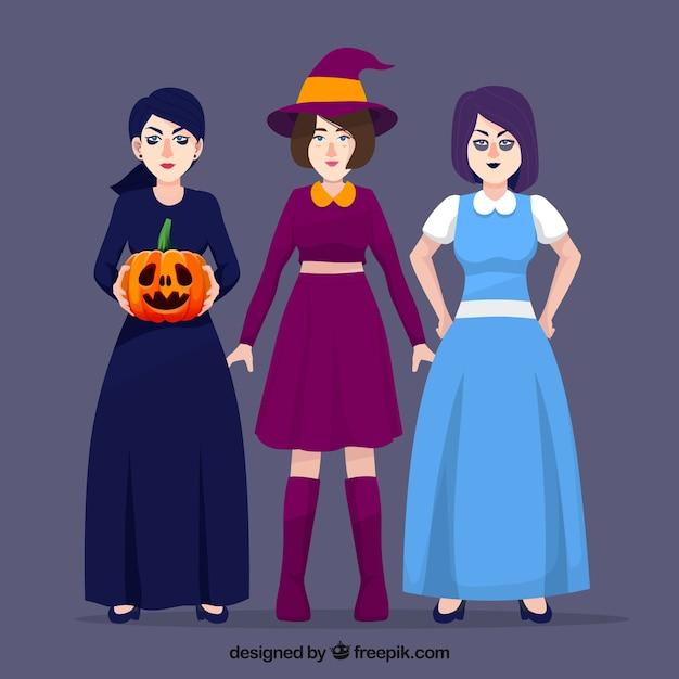 Women halloween disguised Free Vector