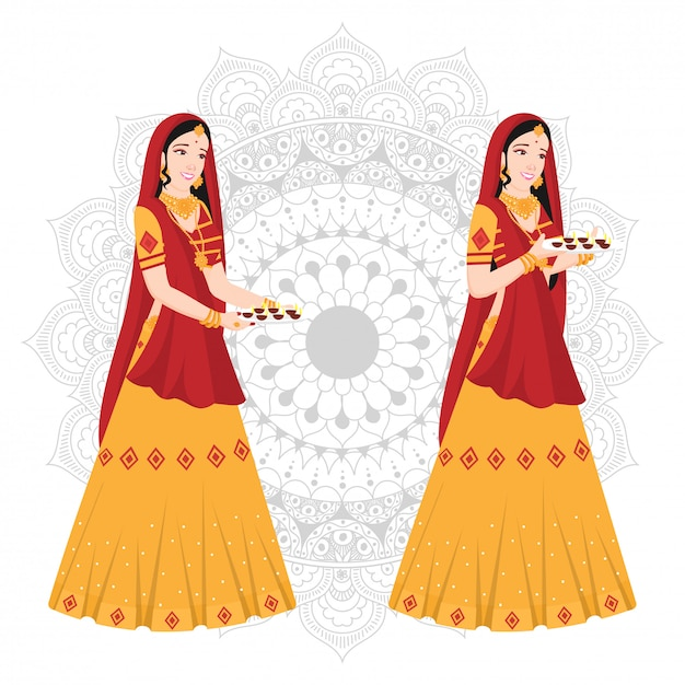 Women in indian traditional attire on mandala. Premium Vector