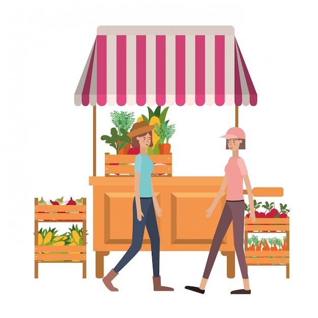 Women in store kiosk with vegetables avatar character Premium Vector