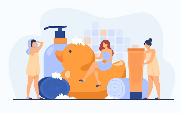 Women wrapped in towels using sponge and soap among bath accessories, tubes and shampoo bottles. vector illustration for bathroom, spa, routine, hygiene concept Free Vector
