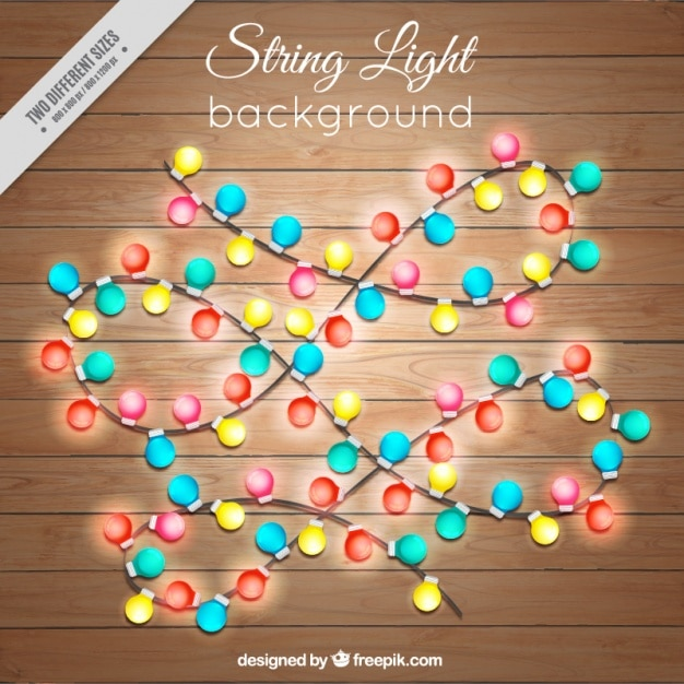 Wooden background with garlands of lights Free Vector