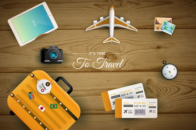Wooden background with travel elements Free Vector