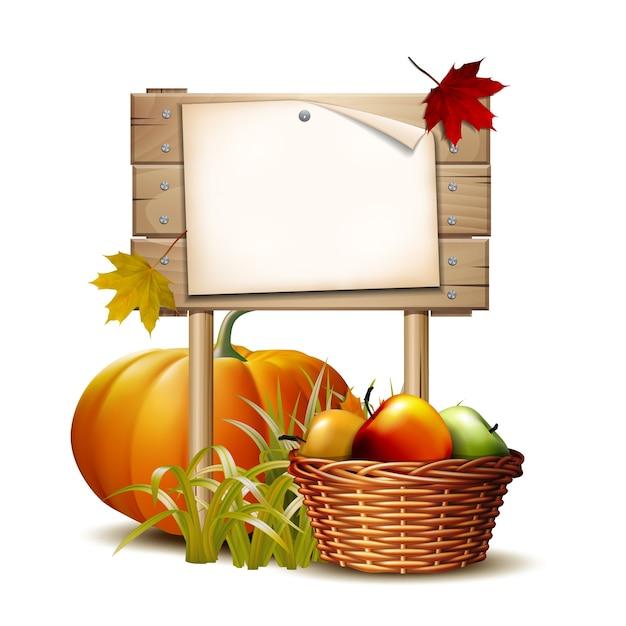 Деревянный баннер с оранжевой тыквой, осенними листьями и корзиной полных спелых яблок. Premium векторы