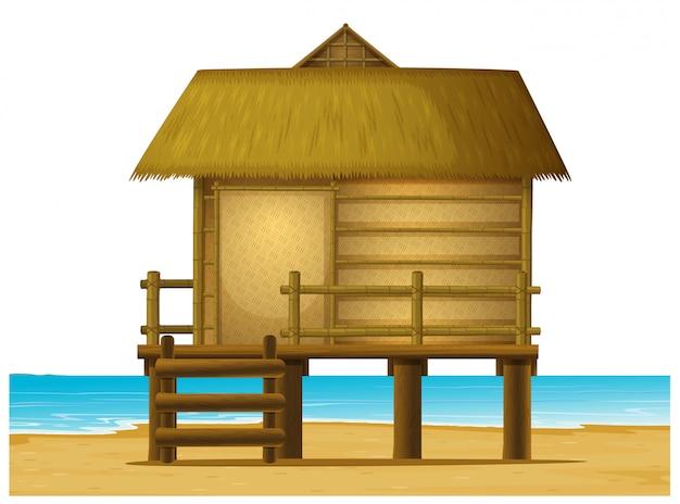 Wooden bungalow on the beach Premium Vector