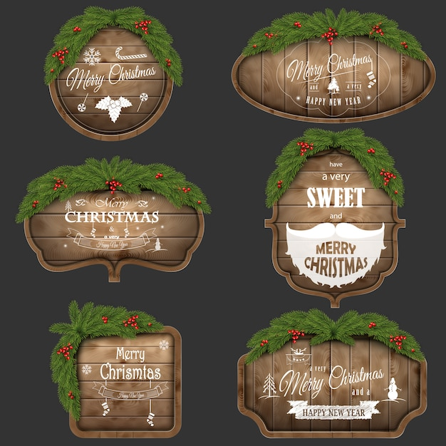 Wooden christmas board set with pine branches and holiday wishes. Premium Vector