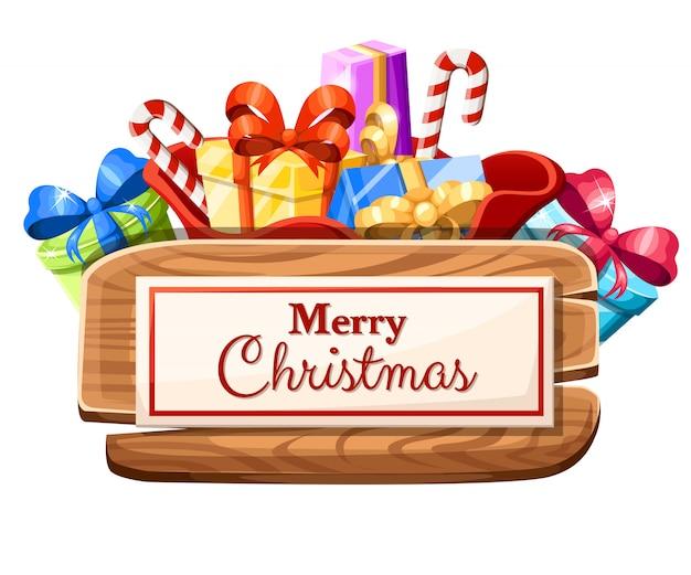 一連のギフトと白い背景の上のメリークリスマスイラストと碑文の木製クリスマスボード Premiumベクター