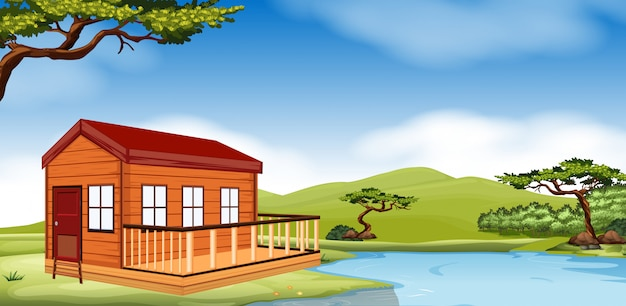 Wooden cottage by the river Premium Vector