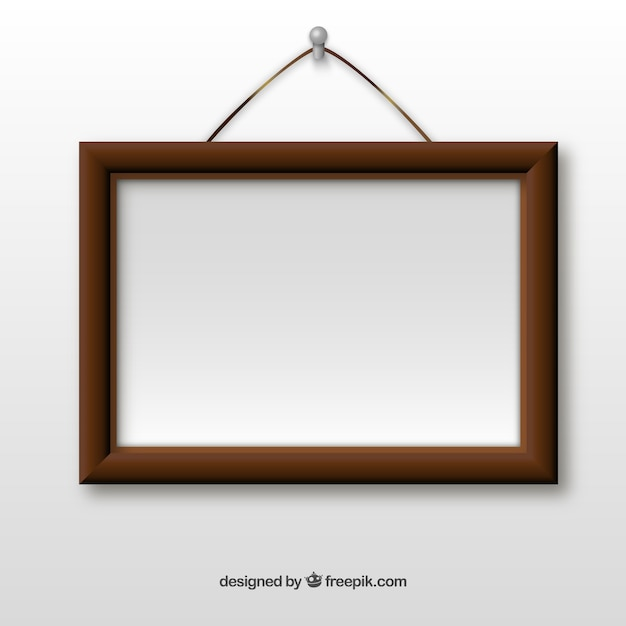 Wooden frame hanging on wall Vector | Free Download