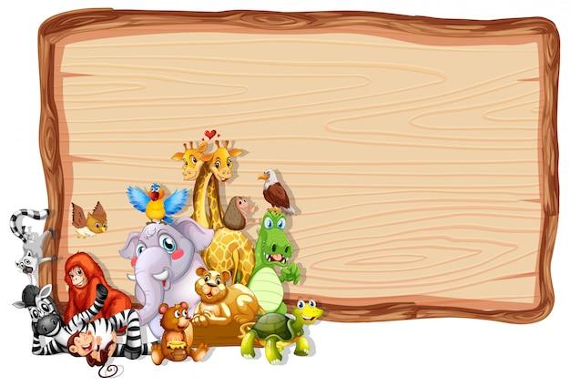 かわいい動物と木製フレーム 無料ベクター