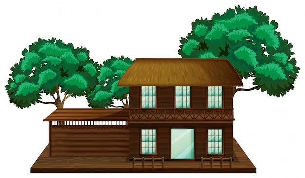 Casa di legno con la scena dell'illustrazione degli alberi Vettore gratuito