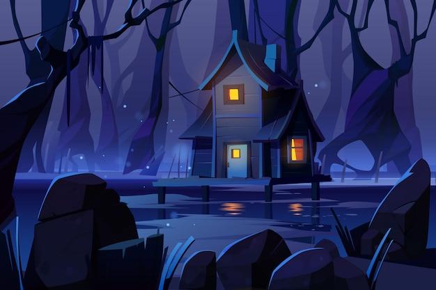 Casa mistica in legno su palafitte sulla palude nella foresta di notte Vettore gratuito