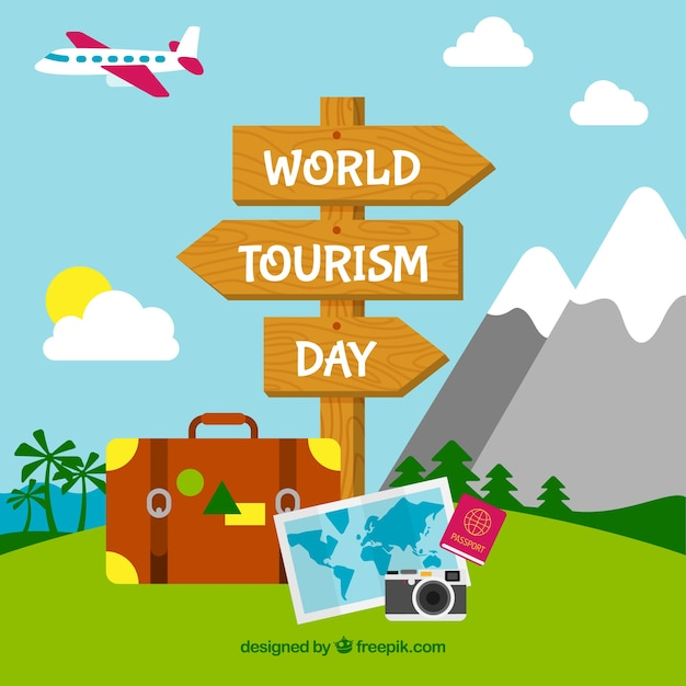 Wooden sign in a beautiful landscape for the world tourism day