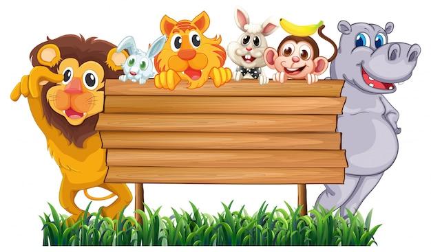 Cartello in legno con molti animali Vettore gratuito