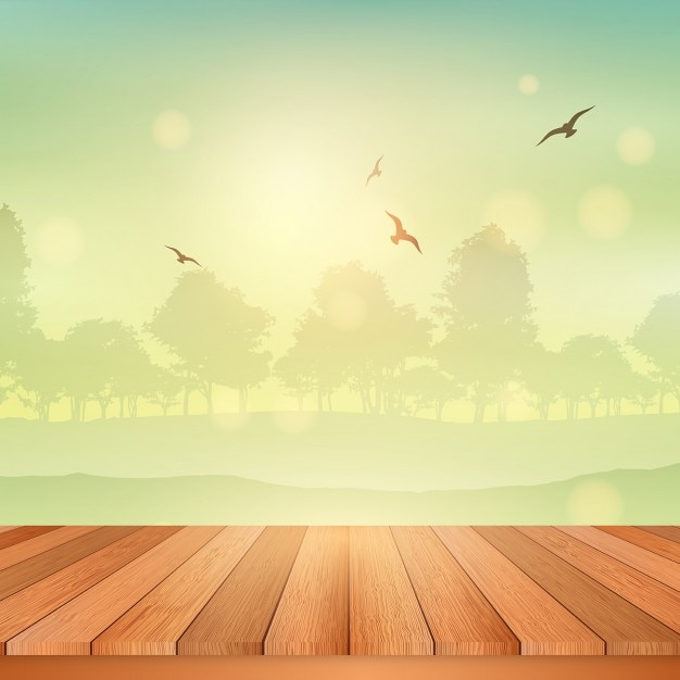 Wooden table looking out to a view of a sunny landscape Free Vector