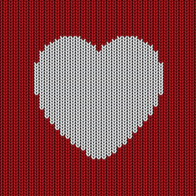 Woolen background with a heart Free Vector