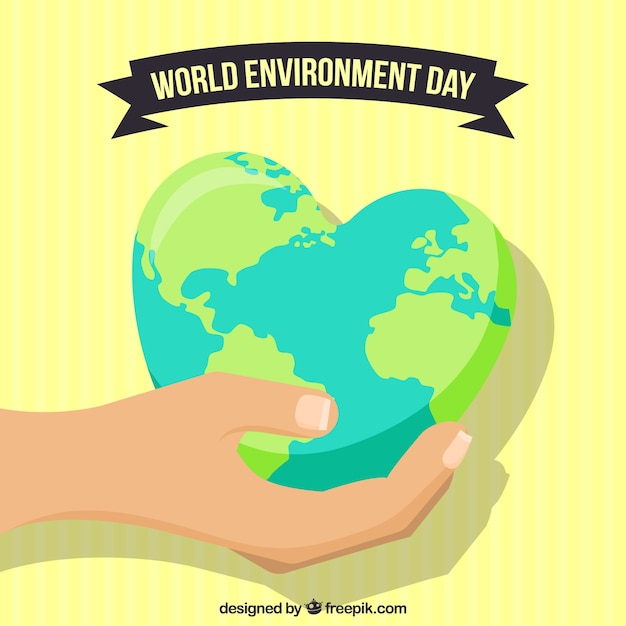 World environment day background with hand holding earth globe with heart shape Free Vector
