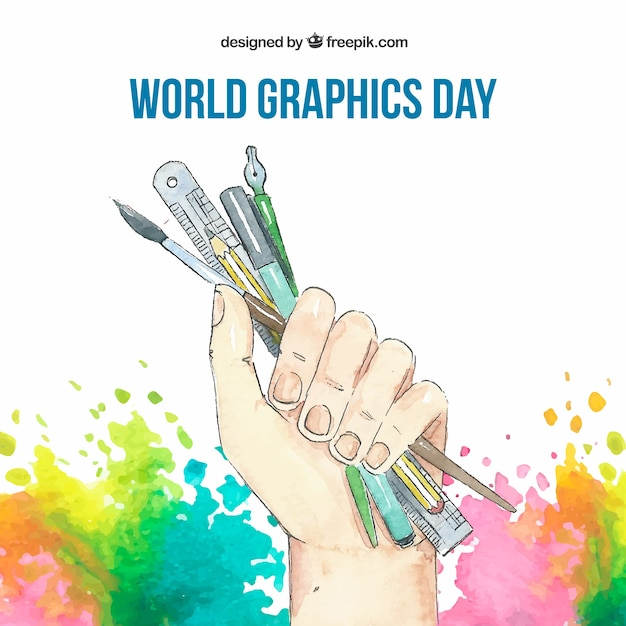 World graphics day background with hand holding tools to drawing in watercolor style Free Vector