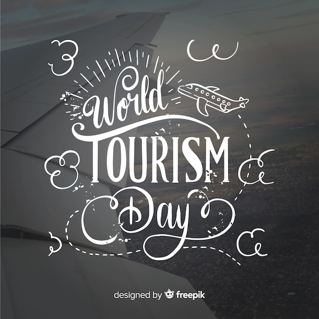 World tourism day background with typograhy Free Vector