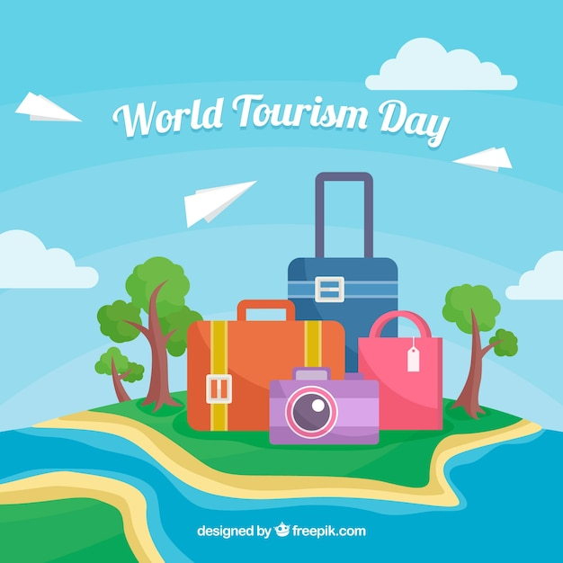 World tourism day, island with suitcase and a photo camera