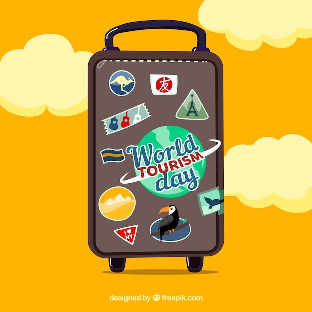 World tourism day with travel bag and clouds