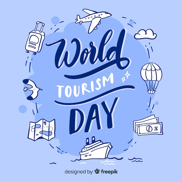 World tourism day with travel items lettering Free Vector