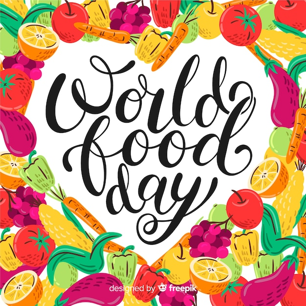 Worldwide food day lettering with a lot of veggies Free Vector