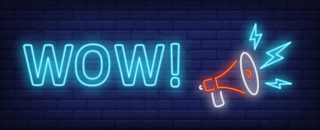 Wow neon text with megaphone Free Vector