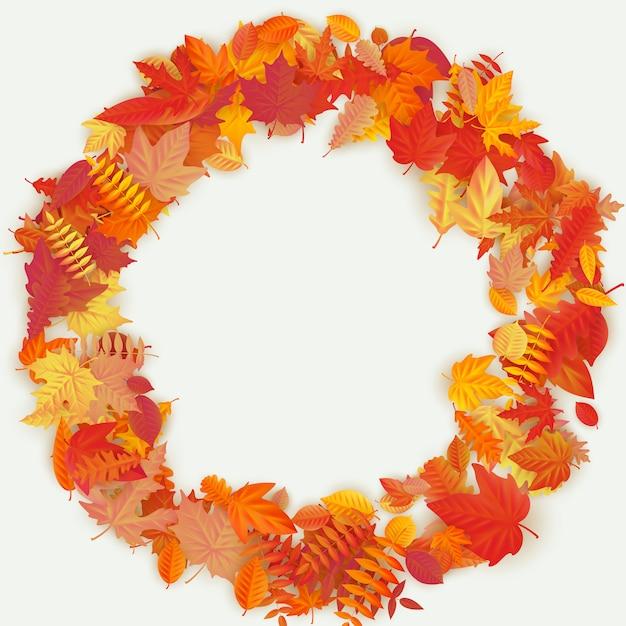 秋の花と明るい背景の葉で作った花輪。秋の組成物。 Premiumベクター
