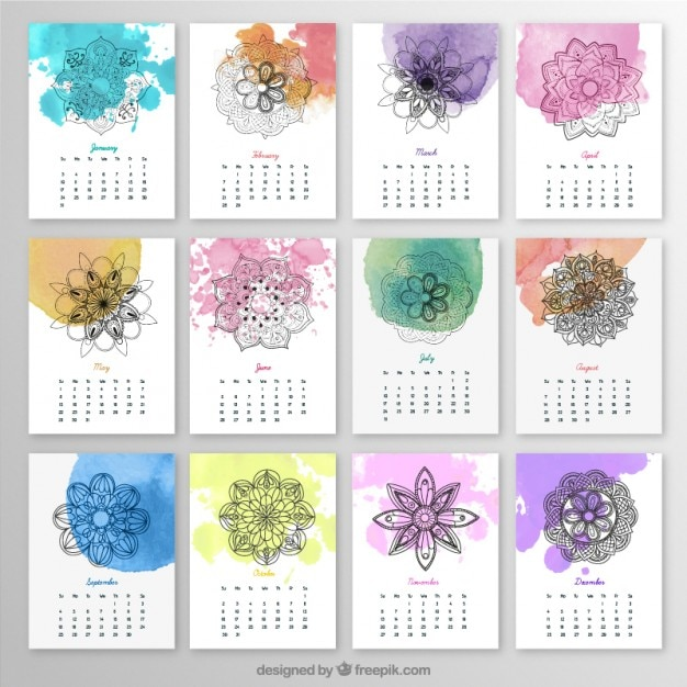 Yearly calendar with mandalas and watercolor splashes Free Vector