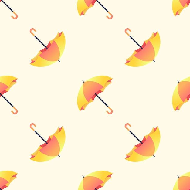 黄色の背景に黄色とオレンジ色の傘のシームレスなパターン。 Premiumベクター