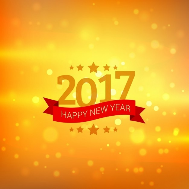 yellow bokeh new year background with red ribbon free vector
