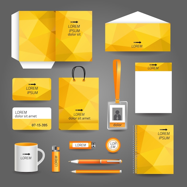 Yellow corporate stationery with geometric design Premium Vector