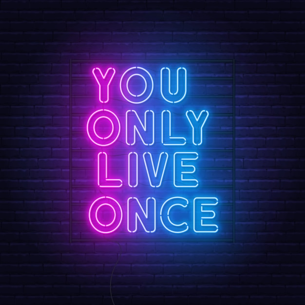 You only live once neon lettering on a brick wall. Premium Vector