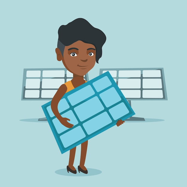 Young african-american woman holding solar panel. Premium Vector