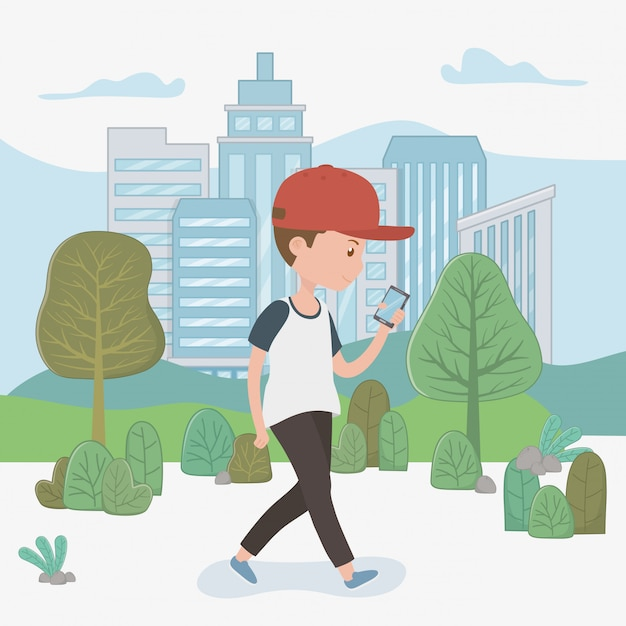 Young boy walking using smartphone in the park Free Vector