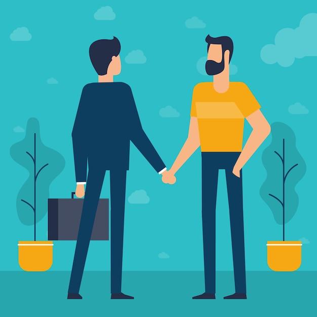 握手する若いビジネスマン Premiumベクター