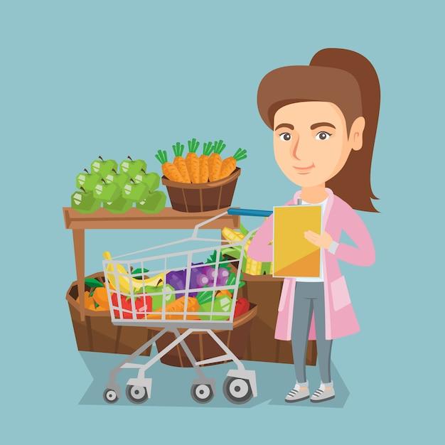Young caucasian woman checking a shopping list. Premium Vector