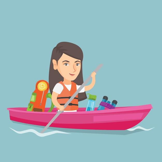 Young caucasian woman riding a kayak. Premium Vector