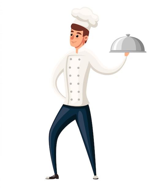 若いシェフ。白い背景のイラスト。漫画のキャラクター 。笑みを浮かべて男、銀の大皿を保持しているシェフ Premiumベクター