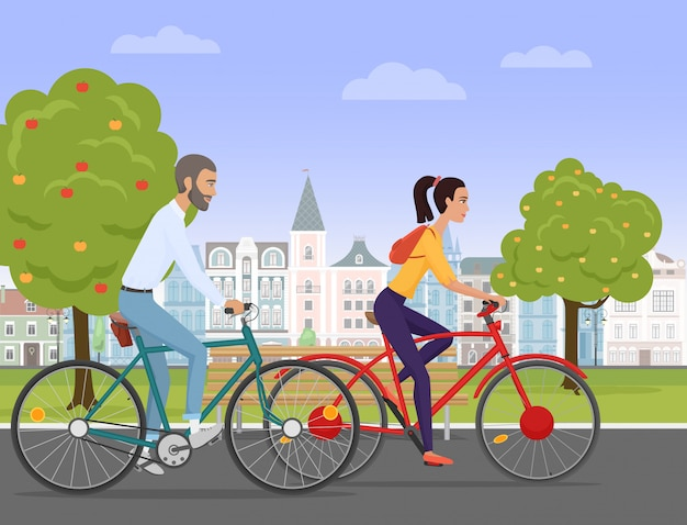 Young couple riding bikes in the old city Premium Vector