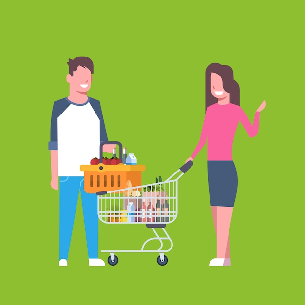 Young couple shopping holding cart and basket full of grocery products Premium Vector