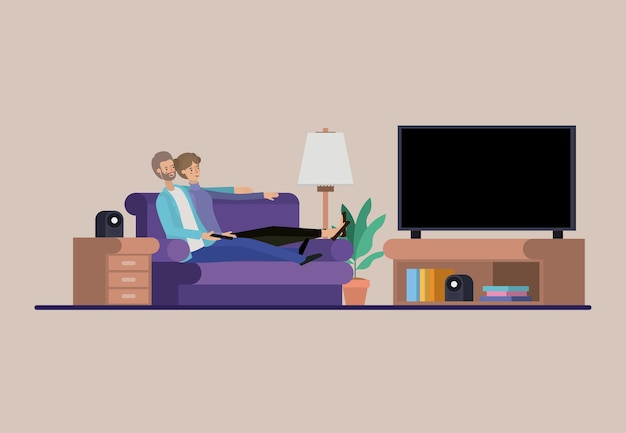 Young couple watching tv on the livingroom Premium Vector
