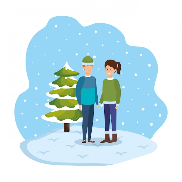 Young couple with winter clothes in snowscape Premium Vector