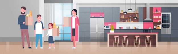 Young family holding bags with grocery products in kitchen room Premium Vector