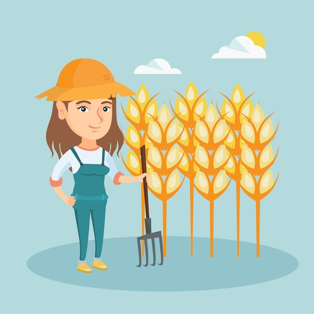 Young farmer standing in a field with pitchfork. Premium Vector