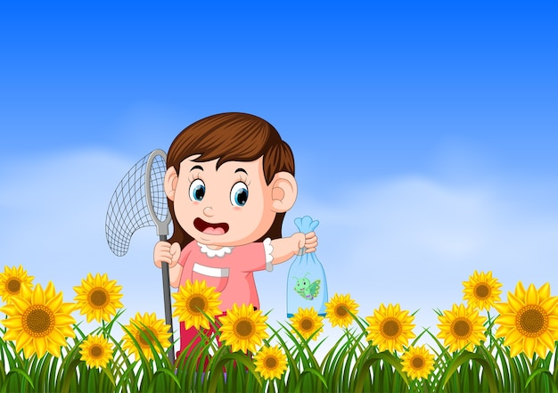 Young girl catching butterflyin the jungle Premium Vector