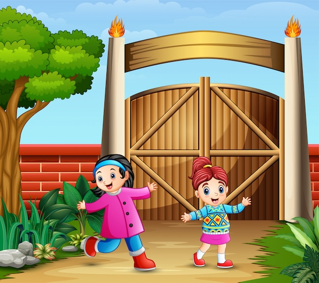 Young girls playing inside the gate Premium Vector
