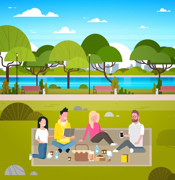 Young group of friends weekend picnic in park people outdoors sitting on grass relaxing Premium Vector