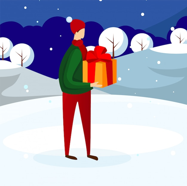 Young guy in winter clothing holding present box. Premium Vector